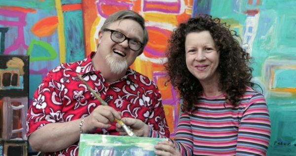 Peter Rowe, working with his art teacher, Cheryl Nonmus